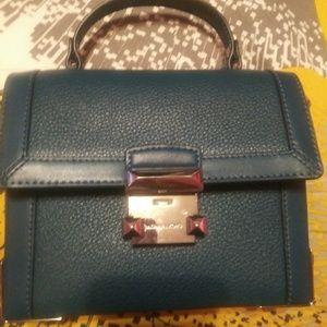 Blue Michael Kors mini suitcase crossbody